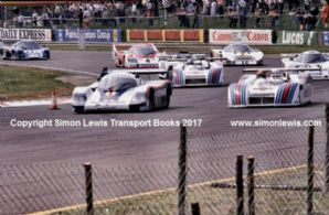 Porsche 956 (Ickx) & Lanica LCI (Ghinzani)leads rolling start at speed Silverstone 6 Hours Group C 1982